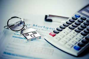 calculator and keys on top of a home equity loan