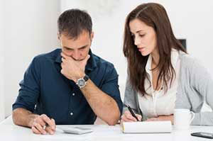couple considering a debt consolidation loan