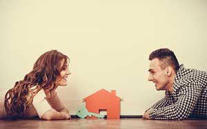 couple discussing the benefits of a down payment assistance loan