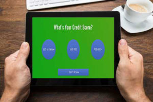 man checking his credit score for his debt consolidation loan