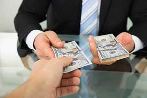 man paying closing costs to mortgage broker