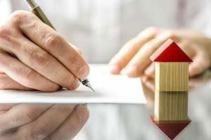 man signing FHA mortgage insurance policy