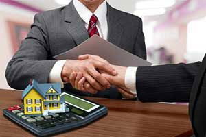 mortgage broker giving man military home loan