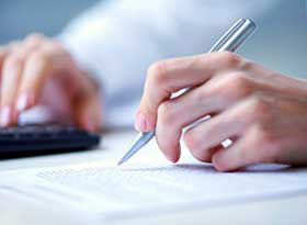 mortgage broker signing document at Fairfax Mortgage Investments