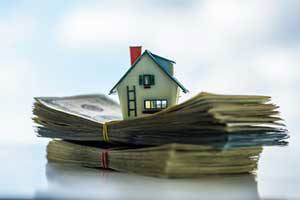 stack of money for a down payment assistance loan