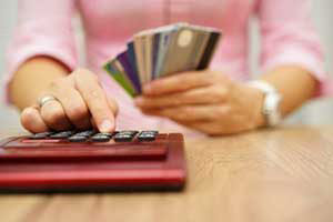 woman calculating her debt and needing a debt consolidation loan