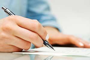 Alexandria, VA mortgage broker signing new home loan
