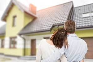 Couple admiring new home after signing a Springfield, VA first time home buyer loan