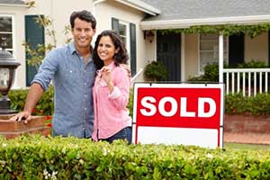 Couple at new home after signing a Winchester, VA first time home buyer loan