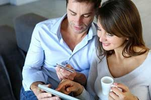 Couple checking out how much money they are saving after a Reston, VA first time home buyer loan