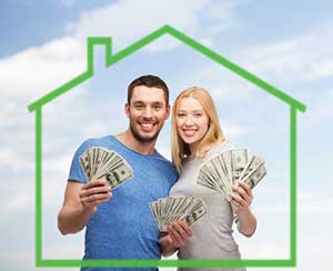 Couple holding cash from assistance from Centreville, VA first time home buyer loan