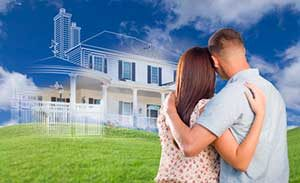 Couple picturing their home after being approved for an Ashburn, VA first time home buyers loan