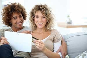 Couple seeing how much money they saved from Annandale, VA first time home buyer assistance