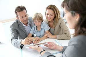 Family signing a Fredericksburg, VA first time home buyer loan