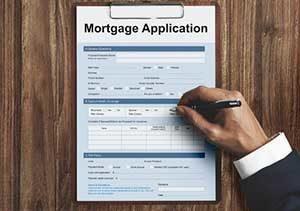 Herndon, VA mortgage broker reviewing a mortgage application