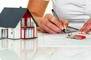 Man signing first time home buyer loan from a Woodbridge, VA mortgage broker