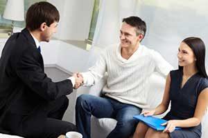 Manassas, VA mortgage brokers providing loan information to couple