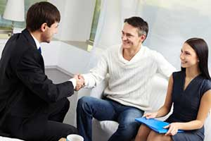 Manassas, VA mortgage brokers providing loan information to couple