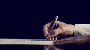 Springfield, VA mortgage broker signing a mortgage application
