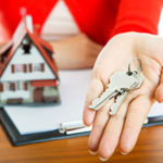 Top Northern Virginia realtor handing keys to homeowner after loan from Northern Virginia mortgage broker