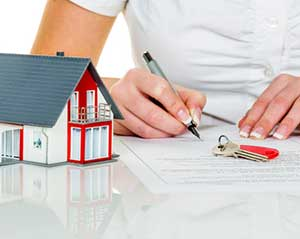 Woman signing first time home buyer loan from Winchester, VA mortgage broker