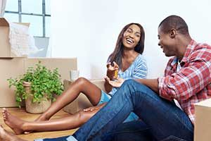 Young couple in home after acquiring a Lorton, VA first time home buyer loan