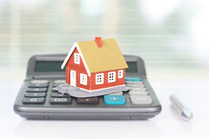 model house on top of a calculator representing home loans