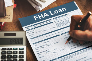 man filling out an FHA loan form in hopes to receive down payment assistance