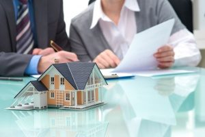 Fairfax mortgage brokers discussing loan policies with new home buyers