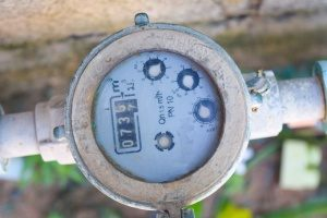 A water meter is among all your other monthly utility costs that do not effect your debt to income ratio.