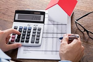 a Fairfax, VA mortgage broker calculating tax deductions for mortgage insurance