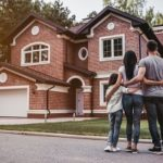 family standing outside a potential home
