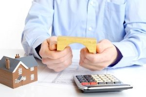 a man holding a block bridge representing mortgage loans