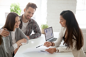 Young couple first time home buyers deciding on home loan