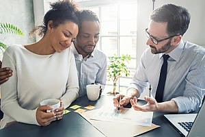 a couple purchasing mortgage insurance while applying for an FHA loan program