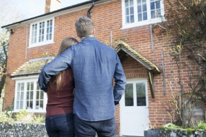 couple looking at their home using First Time Home Buyer Programs In Virginia