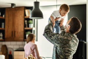 northern virginia veteran holds his child up in the home after buying it