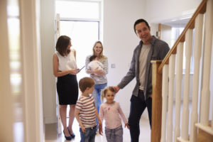 realtor gives a tour of the home to the first time home buyers