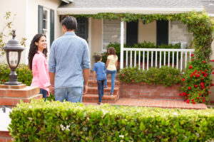 first time home buyer and family walk towards their new house